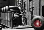 Image of workers rolling large tire tubes Akron Ohio USA, 1941, second 22 stock footage video 65675030483