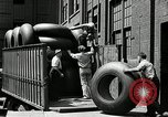 Image of workers rolling large tire tubes Akron Ohio USA, 1941, second 23 stock footage video 65675030483