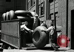 Image of workers rolling large tire tubes Akron Ohio USA, 1941, second 24 stock footage video 65675030483