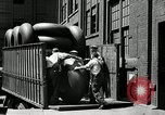 Image of workers rolling large tire tubes Akron Ohio USA, 1941, second 25 stock footage video 65675030483