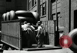 Image of workers rolling large tire tubes Akron Ohio USA, 1941, second 26 stock footage video 65675030483