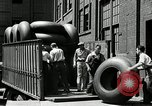 Image of workers rolling large tire tubes Akron Ohio USA, 1941, second 27 stock footage video 65675030483