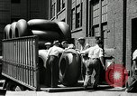 Image of workers rolling large tire tubes Akron Ohio USA, 1941, second 29 stock footage video 65675030483