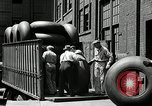 Image of workers rolling large tire tubes Akron Ohio USA, 1941, second 31 stock footage video 65675030483