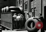 Image of workers rolling large tire tubes Akron Ohio USA, 1941, second 32 stock footage video 65675030483