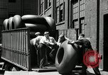 Image of workers rolling large tire tubes Akron Ohio USA, 1941, second 33 stock footage video 65675030483