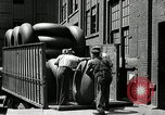 Image of workers rolling large tire tubes Akron Ohio USA, 1941, second 34 stock footage video 65675030483