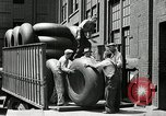 Image of workers rolling large tire tubes Akron Ohio USA, 1941, second 35 stock footage video 65675030483