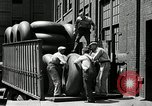 Image of workers rolling large tire tubes Akron Ohio USA, 1941, second 36 stock footage video 65675030483