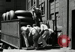 Image of workers rolling large tire tubes Akron Ohio USA, 1941, second 37 stock footage video 65675030483