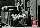 Image of workers rolling large tire tubes Akron Ohio USA, 1941, second 38 stock footage video 65675030483