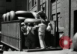Image of workers rolling large tire tubes Akron Ohio USA, 1941, second 40 stock footage video 65675030483