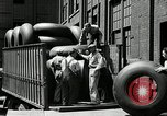 Image of workers rolling large tire tubes Akron Ohio USA, 1941, second 41 stock footage video 65675030483