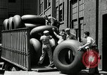 Image of workers rolling large tire tubes Akron Ohio USA, 1941, second 42 stock footage video 65675030483