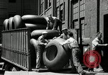 Image of workers rolling large tire tubes Akron Ohio USA, 1941, second 43 stock footage video 65675030483