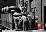 Image of workers rolling large tire tubes Akron Ohio USA, 1941, second 44 stock footage video 65675030483