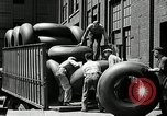 Image of workers rolling large tire tubes Akron Ohio USA, 1941, second 47 stock footage video 65675030483
