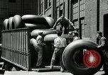 Image of workers rolling large tire tubes Akron Ohio USA, 1941, second 49 stock footage video 65675030483