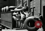 Image of workers rolling large tire tubes Akron Ohio USA, 1941, second 51 stock footage video 65675030483
