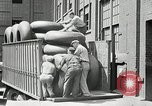 Image of workers rolling large tire tubes Akron Ohio USA, 1941, second 52 stock footage video 65675030483
