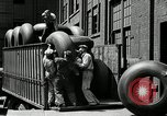 Image of workers rolling large tire tubes Akron Ohio USA, 1941, second 54 stock footage video 65675030483