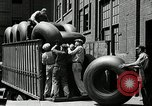 Image of workers rolling large tire tubes Akron Ohio USA, 1941, second 55 stock footage video 65675030483