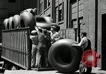 Image of workers rolling large tire tubes Akron Ohio USA, 1941, second 56 stock footage video 65675030483