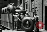 Image of workers rolling large tire tubes Akron Ohio USA, 1941, second 57 stock footage video 65675030483