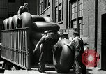 Image of workers rolling large tire tubes Akron Ohio USA, 1941, second 58 stock footage video 65675030483