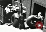 Image of workers rolling large tire tubes Akron Ohio USA, 1941, second 60 stock footage video 65675030483