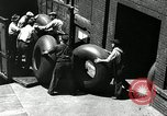 Image of workers rolling large tire tubes Akron Ohio USA, 1941, second 61 stock footage video 65675030483