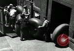 Image of workers rolling large tire tubes Akron Ohio USA, 1941, second 62 stock footage video 65675030483