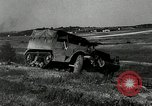 Image of half-track truck blending tank track and tires Akron Ohio USA, 1941, second 18 stock footage video 65675030484