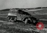 Image of half-track truck blending tank track and tires Akron Ohio USA, 1941, second 19 stock footage video 65675030484