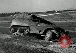 Image of half-track truck blending tank track and tires Akron Ohio USA, 1941, second 20 stock footage video 65675030484