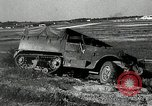 Image of half-track truck blending tank track and tires Akron Ohio USA, 1941, second 21 stock footage video 65675030484
