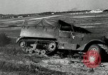 Image of half-track truck blending tank track and tires Akron Ohio USA, 1941, second 22 stock footage video 65675030484