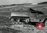 Image of half-track truck blending tank track and tires Akron Ohio USA, 1941, second 23 stock footage video 65675030484
