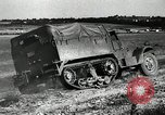 Image of half-track truck blending tank track and tires Akron Ohio USA, 1941, second 30 stock footage video 65675030484