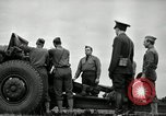 Image of Visiting Latin American officers learn about 155mm howitzer Fort Sill Oklahoma USA, 1942, second 34 stock footage video 65675030493