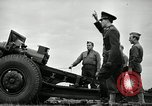 Image of Visiting Latin American officers learn about 155mm howitzer Fort Sill Oklahoma USA, 1942, second 50 stock footage video 65675030493