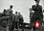 Image of Visiting Latin American officers learn about 155mm howitzer Fort Sill Oklahoma USA, 1942, second 58 stock footage video 65675030493