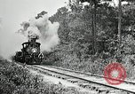 Image of railway construction and paving of muddy roads United States USA, 1927, second 12 stock footage video 65675030520