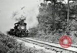 Image of railway construction and paving of muddy roads United States USA, 1927, second 14 stock footage video 65675030520