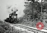 Image of railway construction and paving of muddy roads United States USA, 1927, second 15 stock footage video 65675030520
