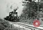 Image of railway construction and paving of muddy roads United States USA, 1927, second 16 stock footage video 65675030520