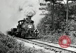Image of railway construction and paving of muddy roads United States USA, 1927, second 17 stock footage video 65675030520