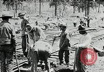 Image of railway construction and paving of muddy roads United States USA, 1927, second 26 stock footage video 65675030520