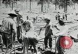 Image of railway construction and paving of muddy roads United States USA, 1927, second 27 stock footage video 65675030520