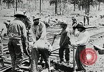 Image of railway construction and paving of muddy roads United States USA, 1927, second 28 stock footage video 65675030520